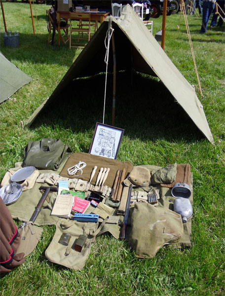 A large collection of military vehicles are on display. A World-War-II pup tent and contents of a field pack are on display (far right). & Brass-in-the-Grass Showu003cbr /u003eu003csmallu003eMay 22 2011u003c/smallu003e